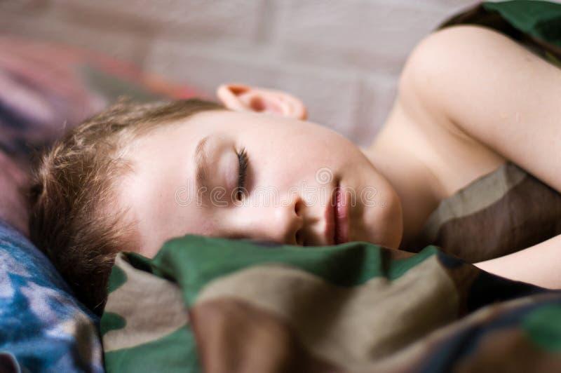 Спать мальчик стоковая фотография