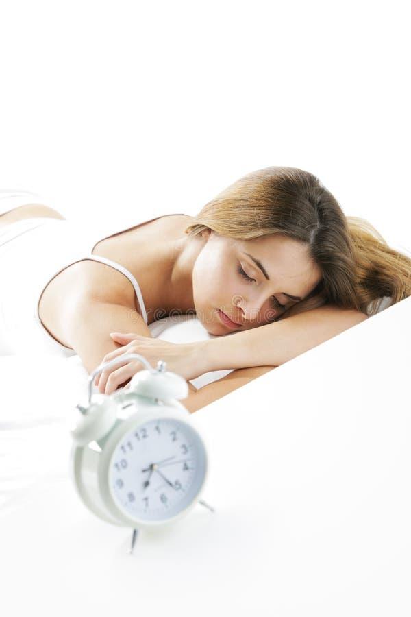 Спать молодой женщины стоковое фото