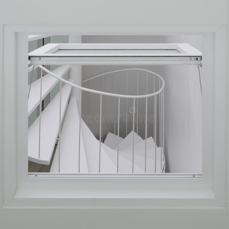 Спиральная лестница через окно стоковая фотография rf