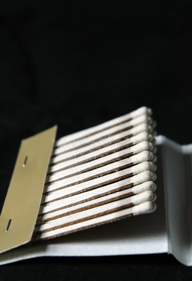 спички черной книги стоковое фото rf