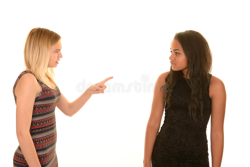Спорить 2 маленьких девочек стоковое фото rf