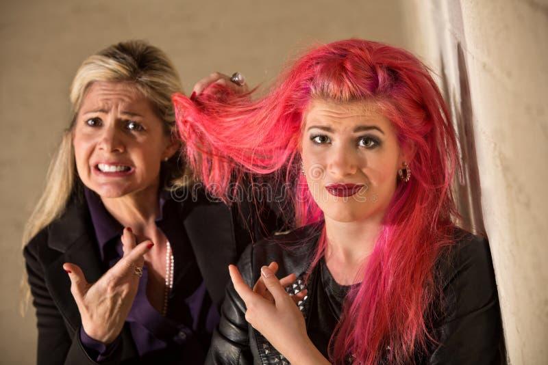 Спорить о Hairdos стоковое фото