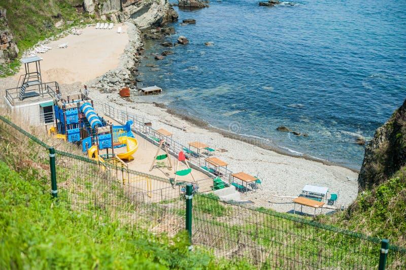 Download Спортивная площадка детей на пляже Стоковое Изображение - изображение насчитывающей оборудование, древне: 81809985