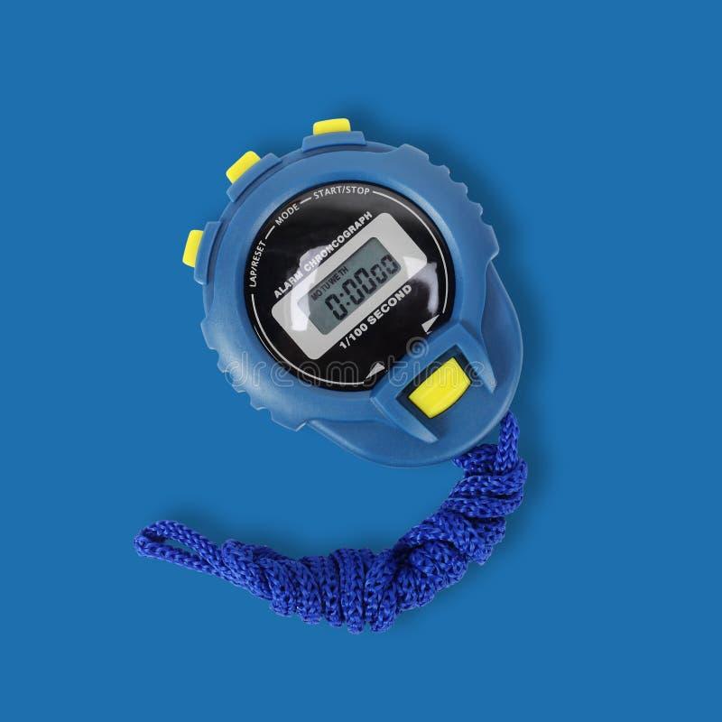 Спортивный инвентарь - голубая предпосылка сини секундомера стоковое фото