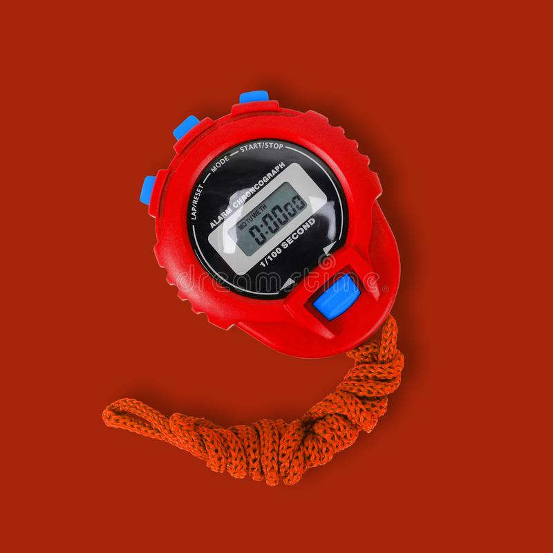 Спортивный инвентарь - красная предпосылка красного цвета секундомера стоковое изображение