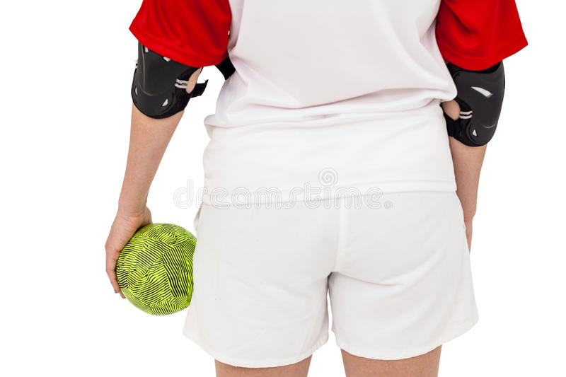 Спортсменка держа шарик стоковое изображение
