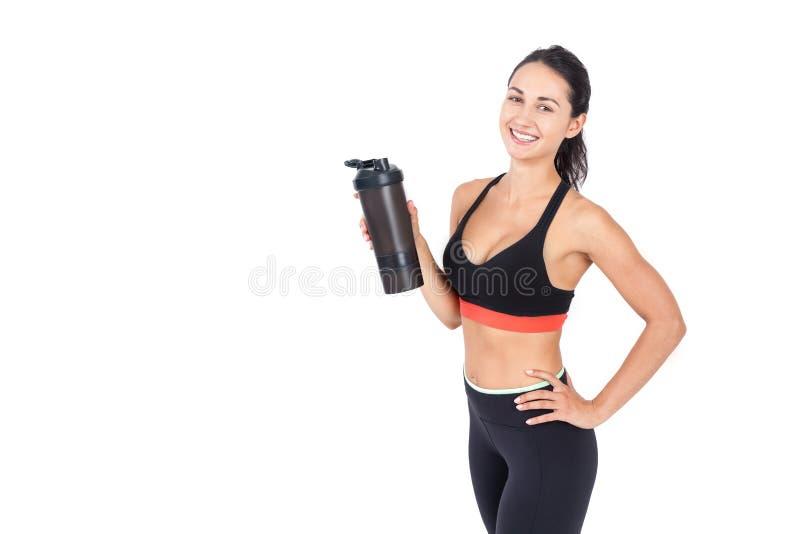 Спортсменка с бутылкой с водой стоковые фотографии rf