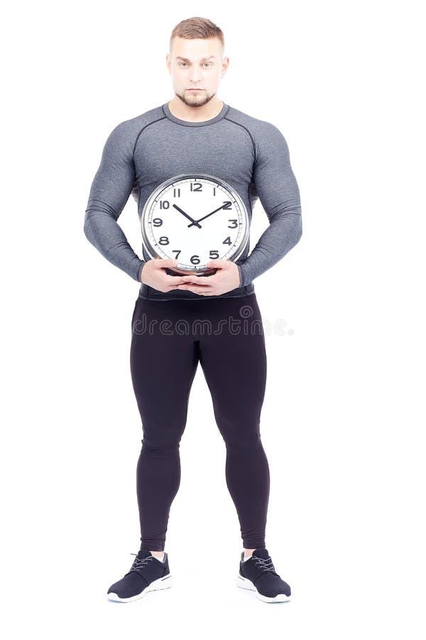 Спортсмен держа часы стоковая фотография