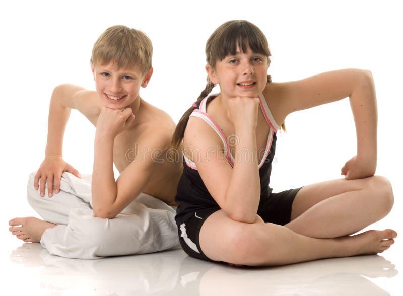 спорт девушки мальчика стоковые изображения rf