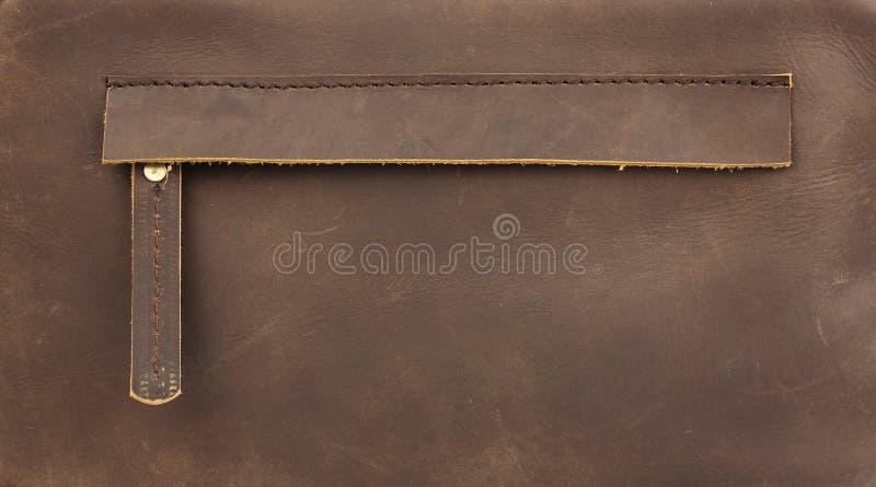 Спрятанное застегнутое на молнию карманн на естественной коричневой коже стоковые изображения