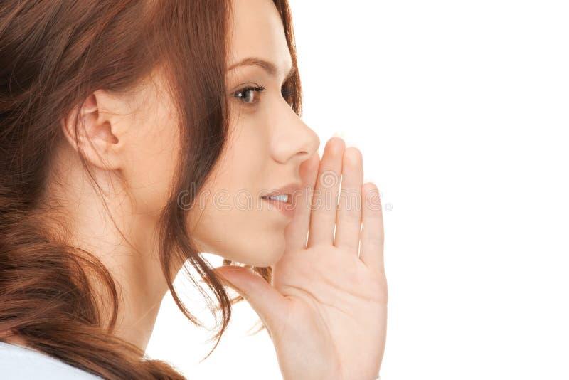 Сплетня женщины шепча стоковое изображение rf