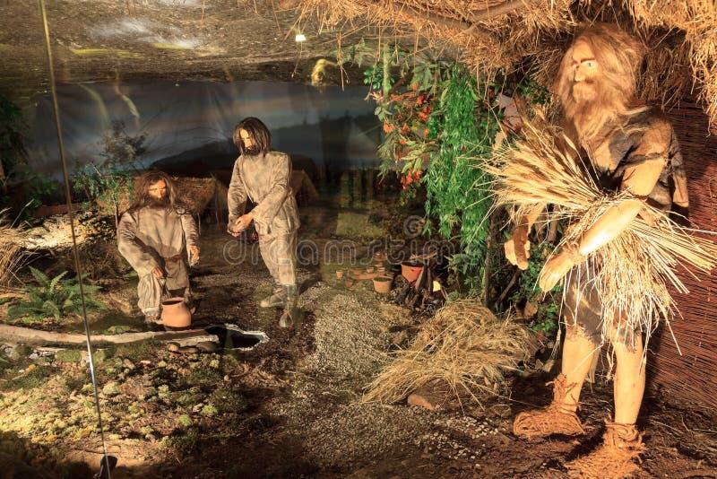 Средневековые горнорабочие на работе в Wieliczka, Польше. стоковое фото