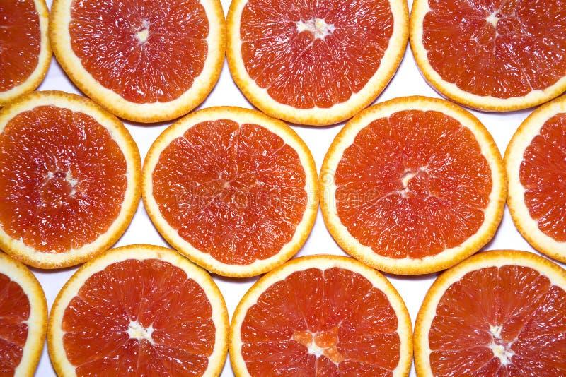 Срезанная красная грапфрутная фоновая текстура стоковые фотографии rf