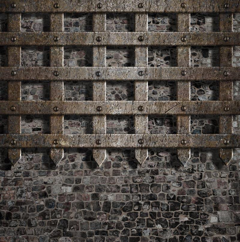 Средневековая старая ржавая решетка металла на каменной стене стоковое изображение rf
