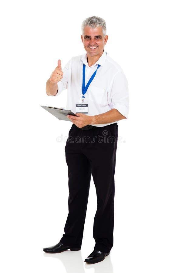 Средний инструктор по вождению времени стоковое фото