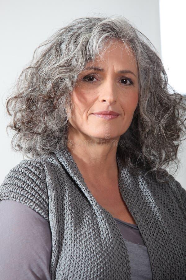 Средн-постаретая женщина стоковые фотографии rf
