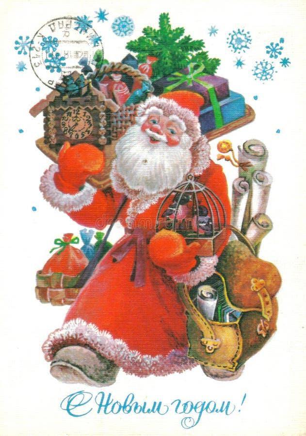 СССР - ОКОЛО 1986: Открытка напечатала в подарках нося СССР - Санта Клауса путем рисуя l Pokhitonov, около 1986 текст стоковое изображение rf