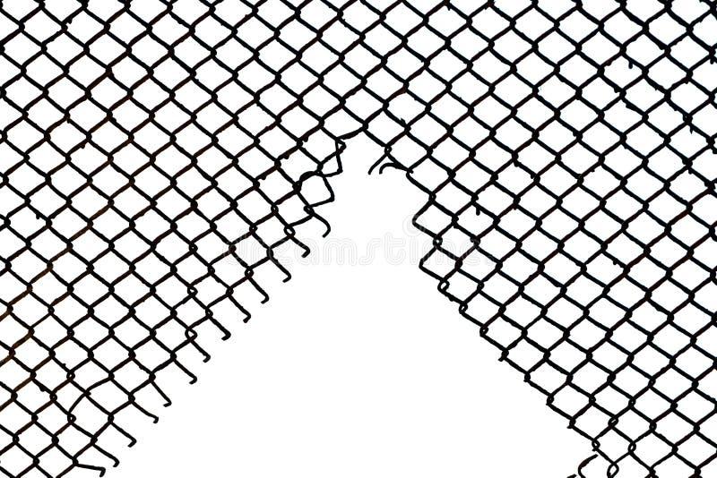 Стальная загородка сетки с сорванной залой в ей стоковые фото