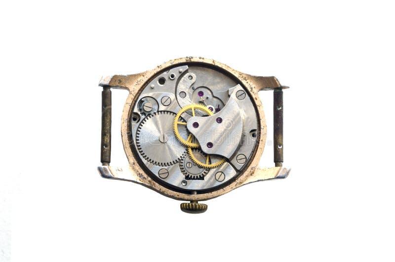 Стальной clockwork старых механически наручных часов белизна изолированная предпосылкой стоковое изображение rf