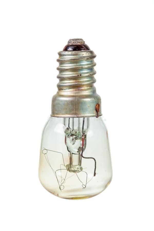 Старая лампочка над белизной стоковые изображения