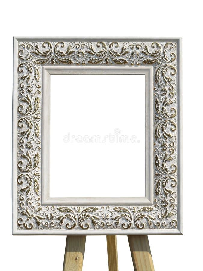 Старая винтажная богато украшенная белая картинная рамка при изолированная картина стоковое изображение