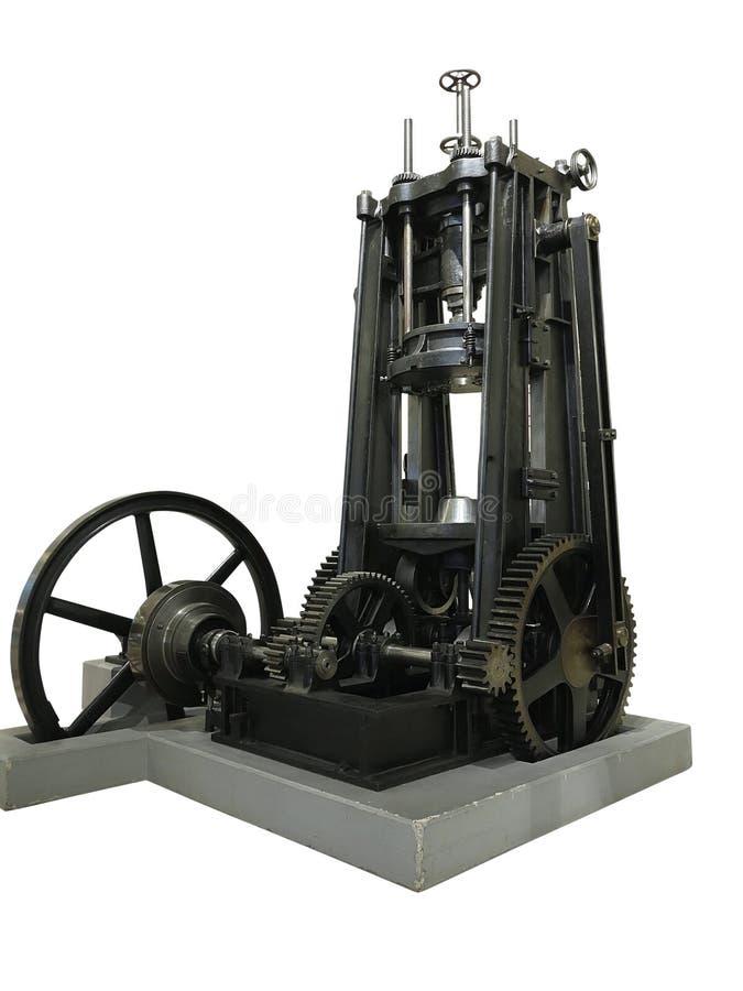 Старая винтажная машина прессы металла изолированная над белой предпосылкой стоковые изображения rf
