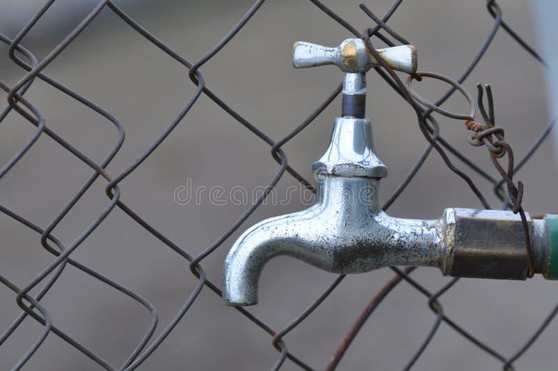 старая вода из крана стоковое изображение