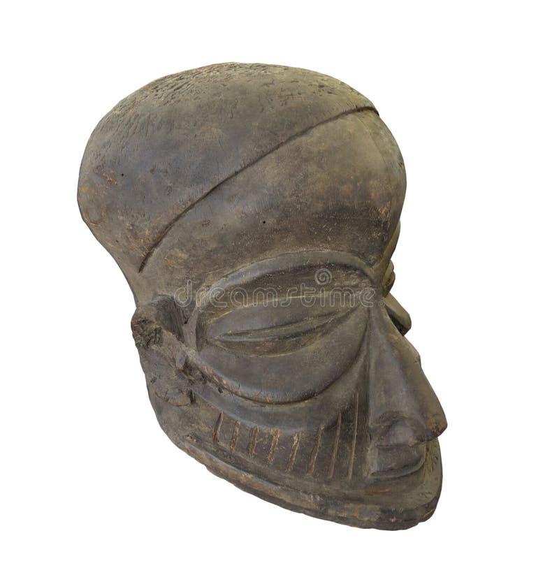 Старая деревянная африканская головная изолированная маска стоковое изображение