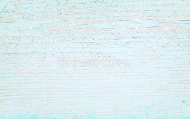 Старая деревянная поверхность с слезать голубую краску стоковое фото