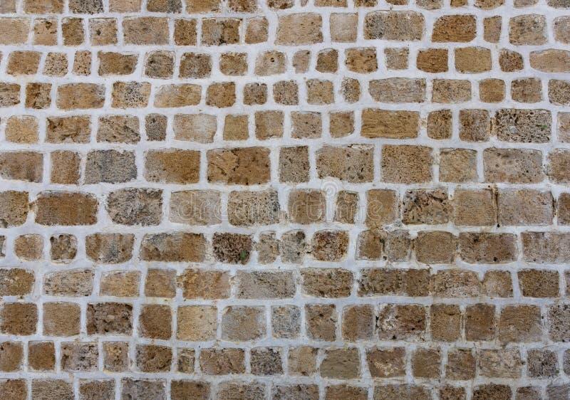 Старая естественная каменная стена как текстура или предпосылка стоковая фотография