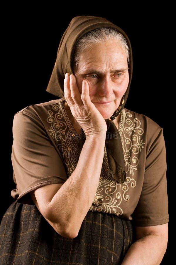 старая женщина тоскливости стоковая фотография