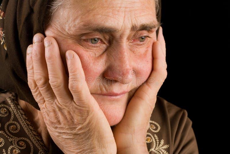 старая женщина тоскливости стоковое фото rf