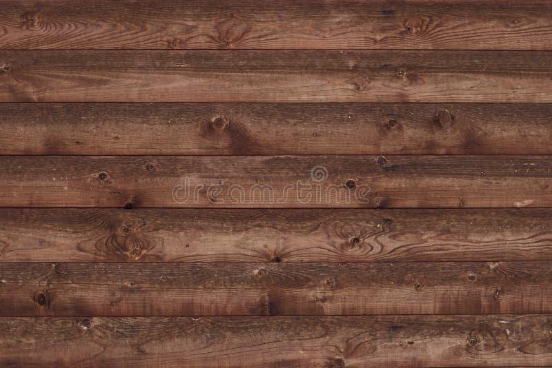 Старая затрапезная деревянная загородка Браун увял доски Таблица дуба, бары, журналы Деревянная поверхность Абстрактная предпосыл стоковые фотографии rf