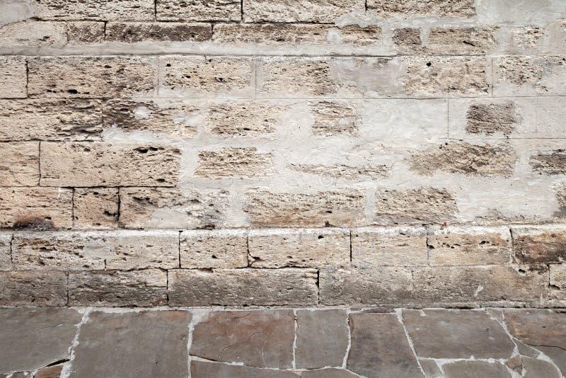 Старая каменной мостовая стены и гранита стоковое изображение rf