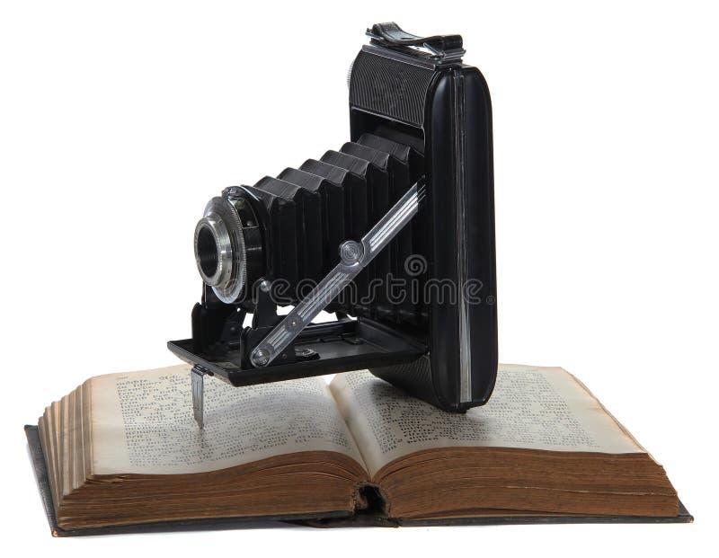 старая камеры книги историческая стоковая фотография