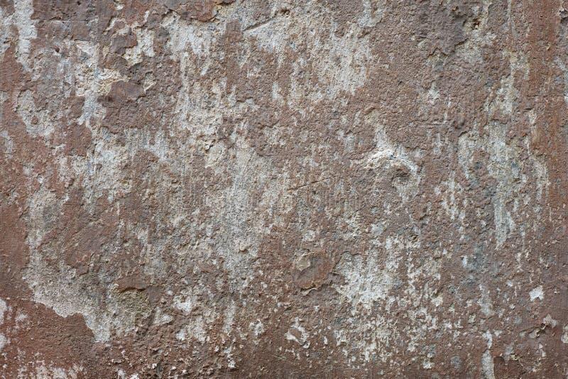 Старая коричневая и серая выдержанная предпосылка стены стоковое фото