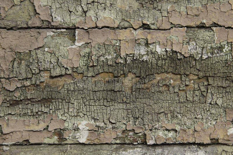 Старая краска на предпосылке деревянных доск стоковая фотография