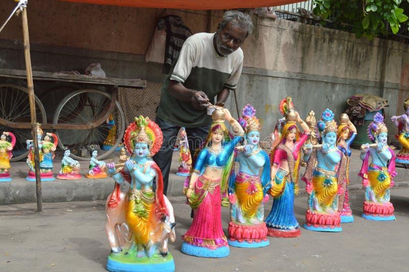 Старая основа красит статую лорда Krishna стоковые фотографии rf