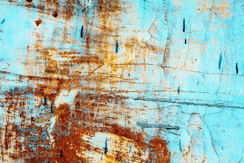 Старая ржавая голубая стена стоковое фото