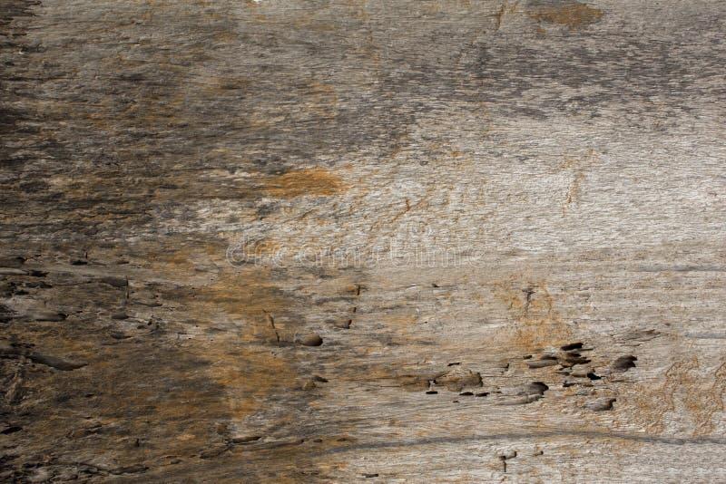 Старая серая белая желтая тухлая деревянная доска грубая естественная поверхностная текстура стоковые фото