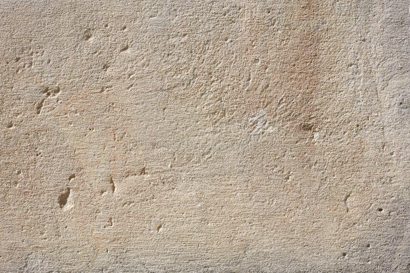 Старая серая предпосылка текстуры стены в солнечном свете стоковые изображения