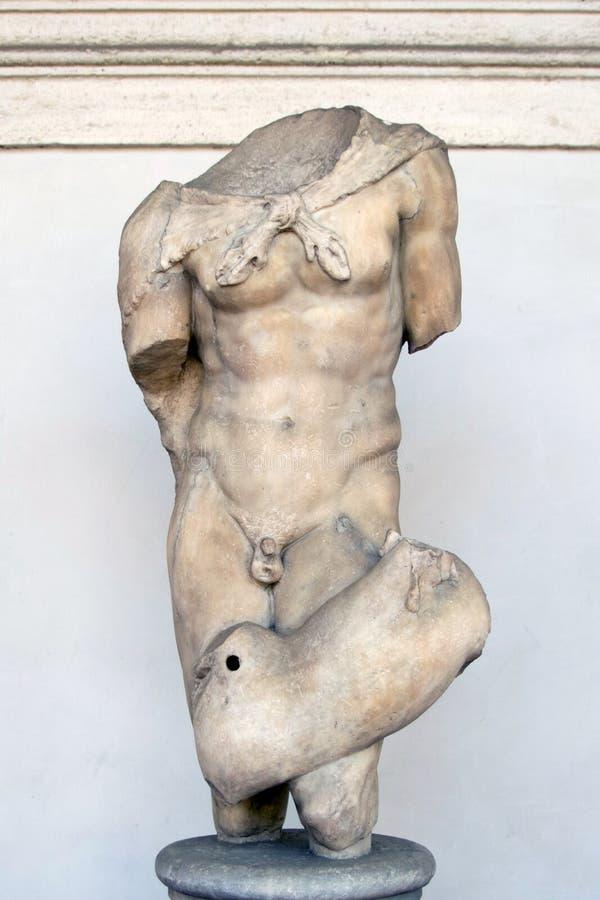 Старая скульптура сатира стоковое фото