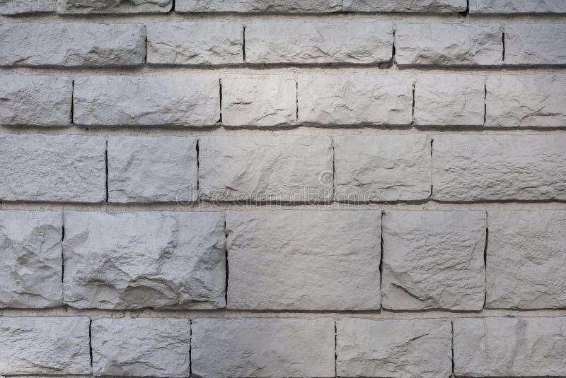Старая срубленная каменная стена, красивая текстура предпосылки стоковое изображение