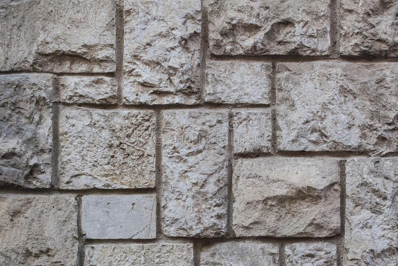 Старая срубленная каменная стена, красивая текстура предпосылки стоковые изображения rf