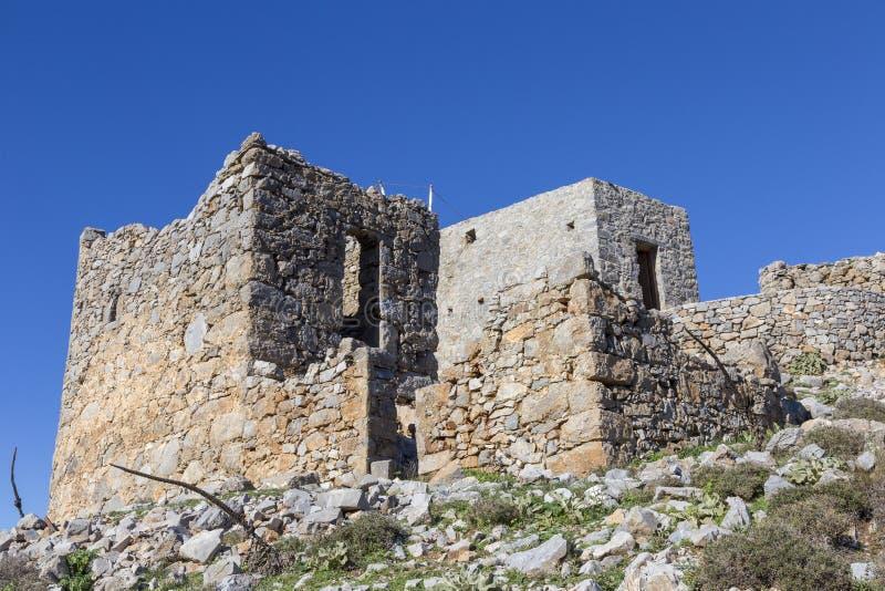 Старая традиционная ветрянка в горе Крит Греция стоковая фотография
