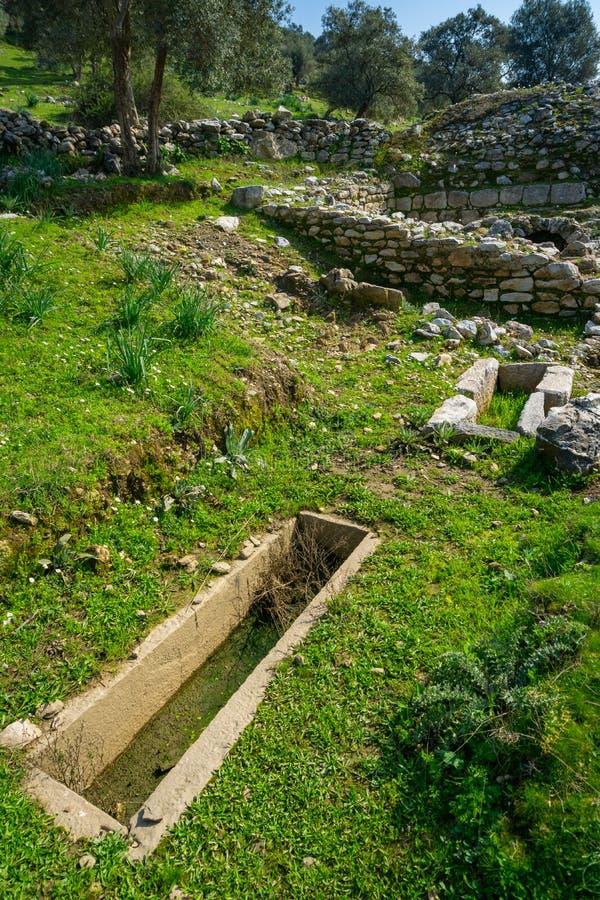 Старая усыпальница или деталь mauseoleum от древнего города Euromos, южного некрополя Греческое и римское поселение стоковые изображения rf