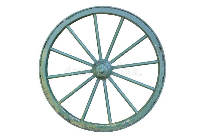 Старое зеленое колесо телеги на белизне стоковые фото