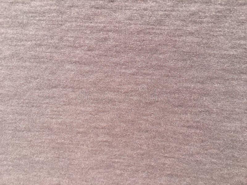 Старой одежды ткани несенные предпосылкой стоковая фотография