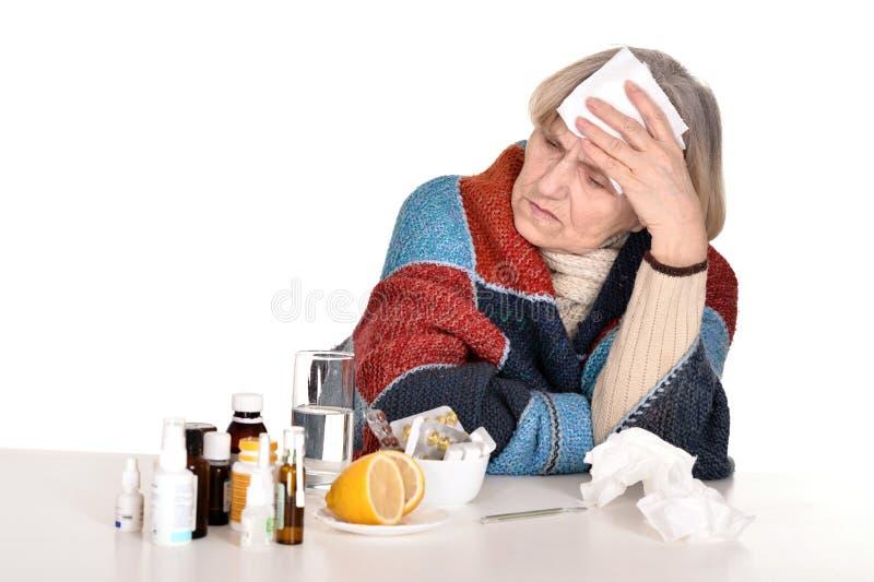 Старуха с головной болью стоковое фото rf