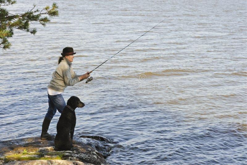 Старшая рыбная ловля женщины стоковые фотографии rf